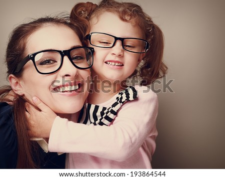 Loving happy mother and smiling daughter hugging. Vintage closeup portrait - stock photo