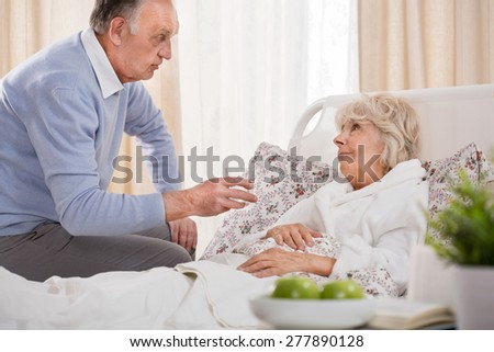 Loving husband caring about ill senior wife