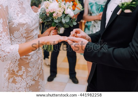 Loving husband puts his wife a ring on her finger, the marriage ceremony by putting on the ring on your finger. Wedding ring - stock photo