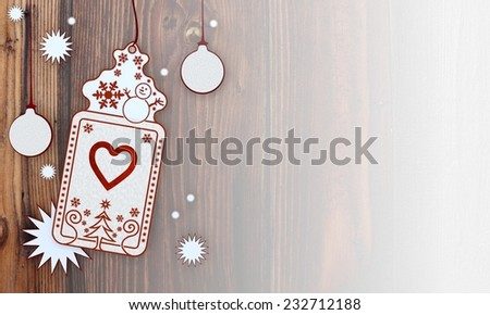 loving illustration of a christmas card with heart label in front of a wooden background with gradient to white