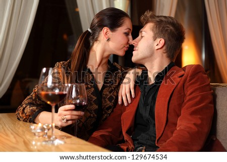 loving man and woman in a restaurant - stock photo