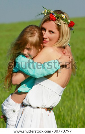 loving mother and daughter on nature - stock photo