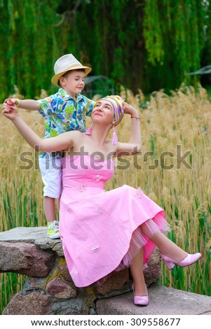 Loving Mother and son playing in summer park