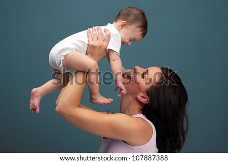 Loving mother holding baby - color studio shot - stock photo