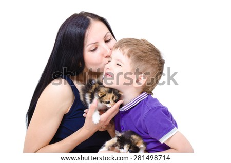 Loving mother kisses son, holding two tricolor kittens, isolated on white background - stock photo