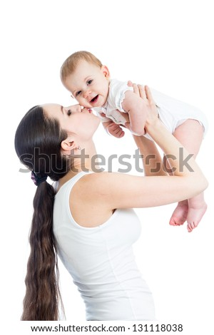 loving mother kissing baby girl isolated on white - stock photo