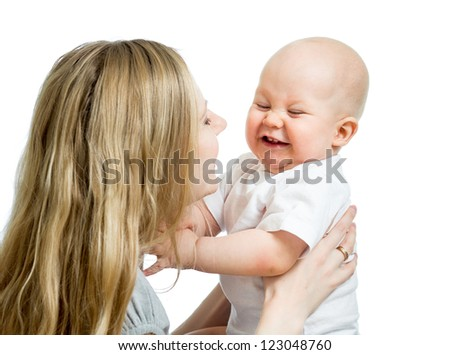 loving mother supporting her child on white background - stock photo