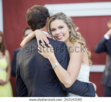 Loving newlyweds dancing on their wedding day - stock photo