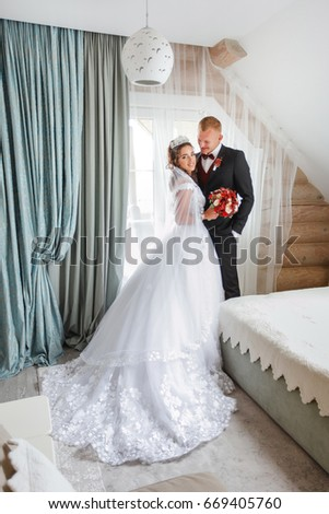 Loving newlyweds in a beautiful house