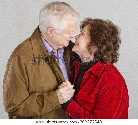 Loving older man and woman kissing each other - stock photo