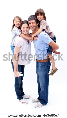 Loving parents giving their children a piggyback ride against a white background
