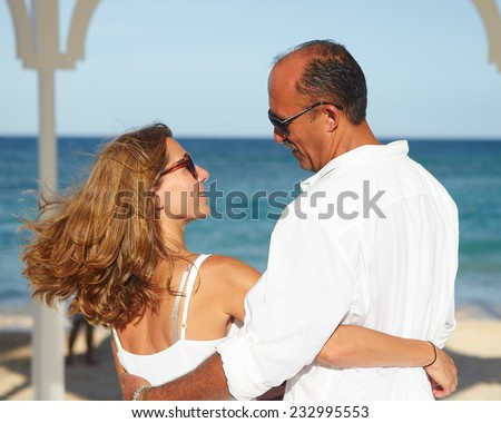 Loving romantic couple relaxing on the beach.