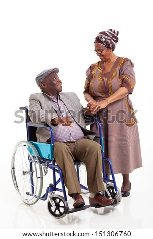 loving senior african wife talking to handicapped husband isolated on white - stock photo