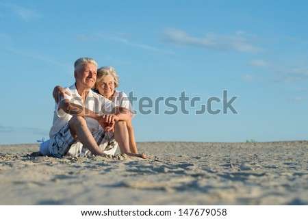 loving senior couple on a background of clear sky - stock photo