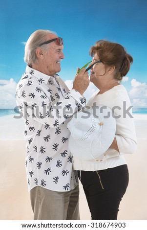 Loving  senior couple standing at the beach