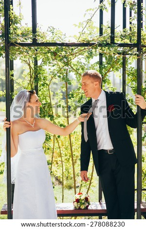 Loving wedding couple outdoor.