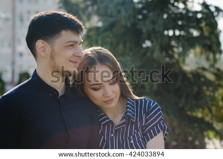 Loving young beautiful calm couple close up portrait