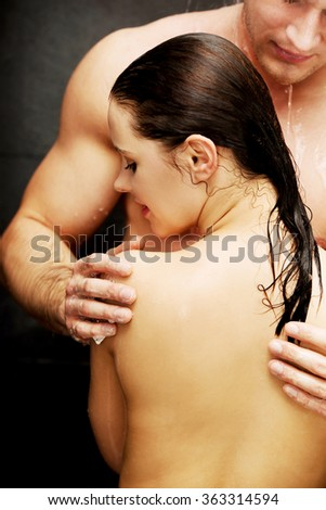 Loving young couple at the shower.