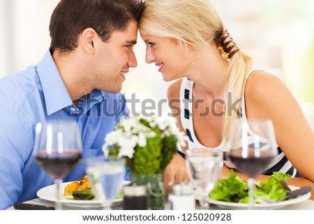 loving young couple dining out in restaurant - stock photo