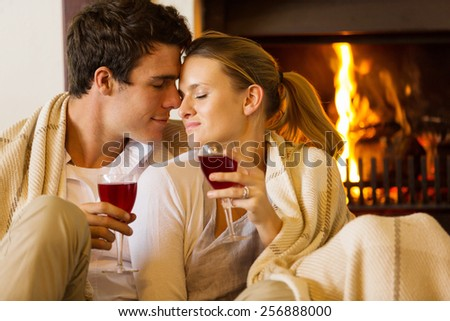 loving young couple enjoying spend time together at home - stock photo