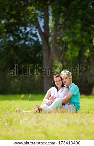 Loving young couple hugging kissing and enjoying each other in a park