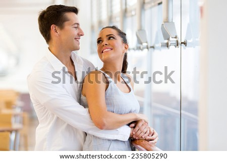 loving young couple looking each other - stock photo
