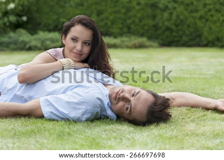 Loving young couple relaxing in park - stock photo