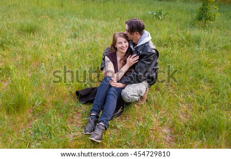 Loving young couple. The girl and the guy have a rest in the open air