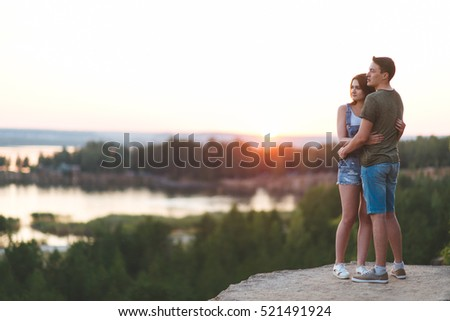 loving young man and woman on the nature