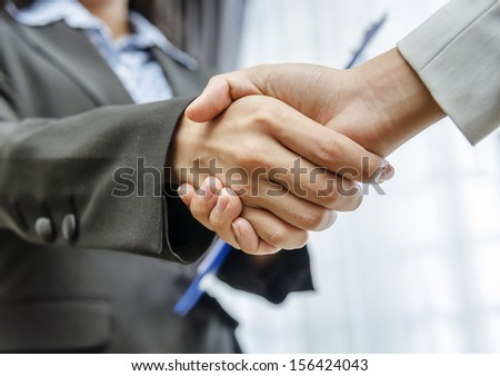 Low angle of businesswomen handshaking