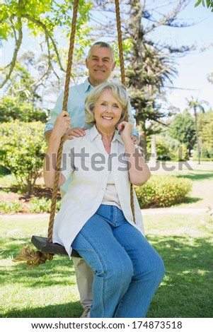 Low angle portrait of a happy mature couple at the park - stock photo