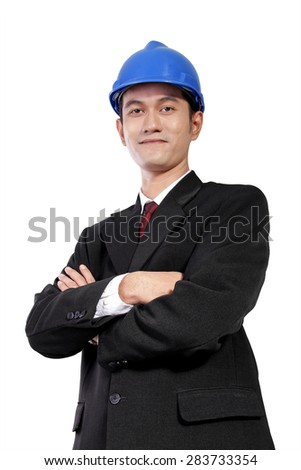 Low angle portrait of young Asian architect in formal wear posing with crossed arms, isolated on white background - stock photo
