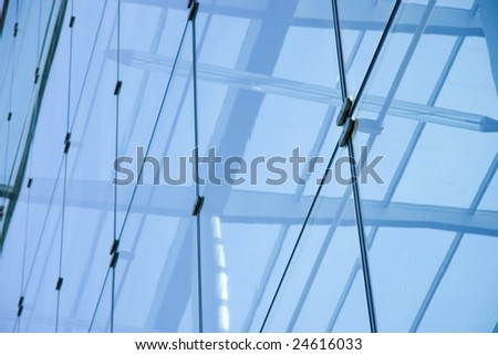 Low angle shot of a glass office block in London - stock photo