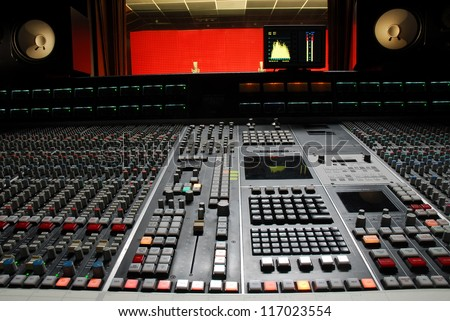 Low angle shot of a mixing desk in music studio - stock photo