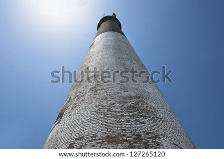 Low angle shot of dry tortugas lighthouse against blue sky - stock photo