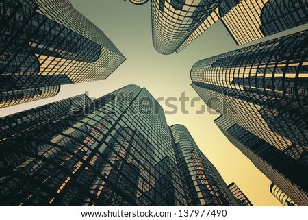 Low angle shot of modern glass city buildings with sunset background. - stock photo
