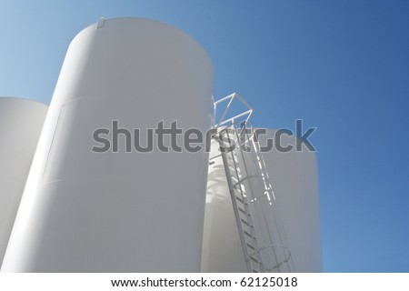 Low angle shot of Oil Refinery Tanks - stock photo