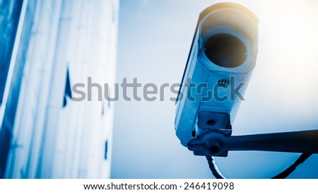 low angle shot on security camera with office building background, shanghai china. - stock photo