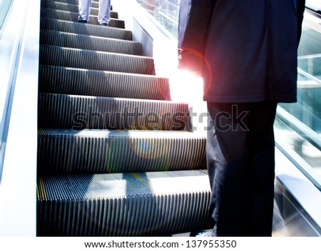 Low angle view looking to top of modern escalator. - stock photo