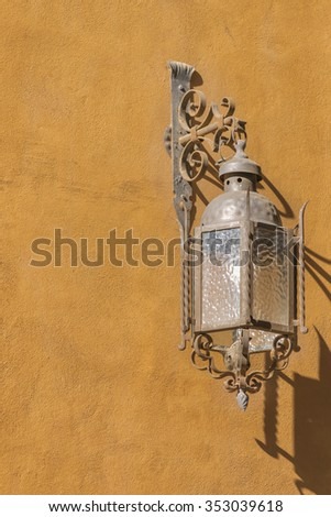 Low angle view minimalistic style photo of antique iron lamp in red wall