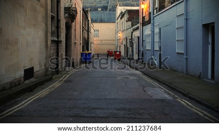 Low Angle View of a Dark Alley in an Inner City Area - stock photo