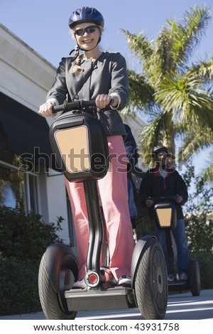 Low angle view of a mid adult woman riding a Segway machine