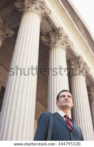 Low angle view of a serious male lawyer outside courthouse - stock photo