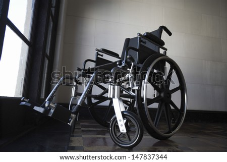Low angle view of a wheelchair in empty room - stock photo
