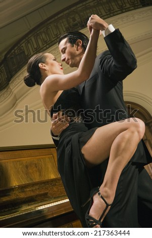 Low angle view of a young couple dancing - stock photo