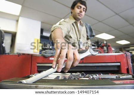 Low angle view of a young man working in workshop