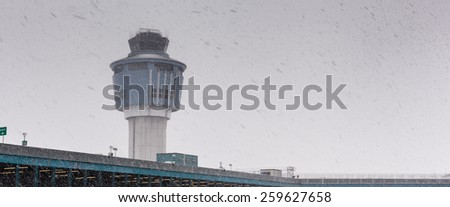 Low angle view of air traffic control tower in winter weather - stock photo