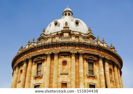 Low angle view of an educational building, Radcliffe Camera, Oxford University, Oxford, Oxfordshire, England - stock photo