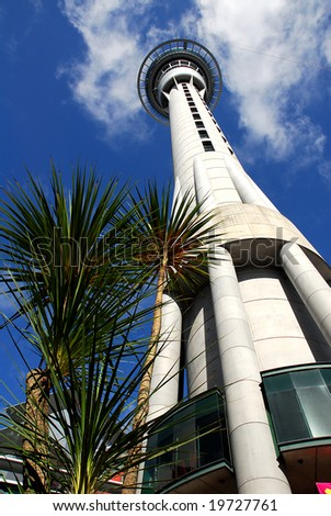 low angle view of auckland's iconic skytower with brilliant blue sky in the background
