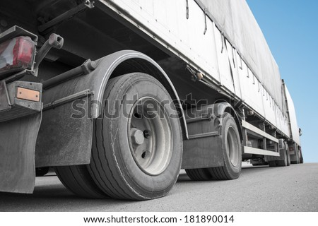 Low angle view of big truck on asphalt - stock photo